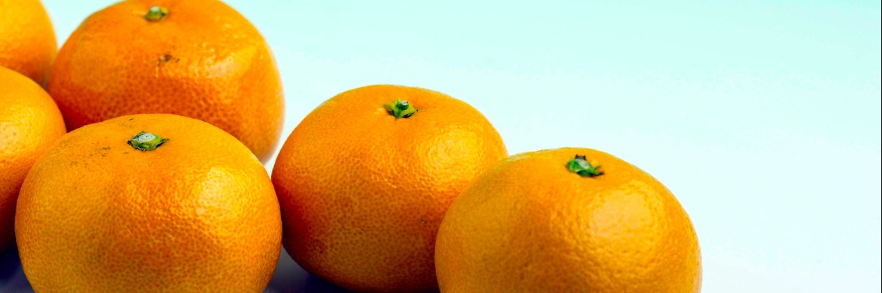 Four oranges grouped together