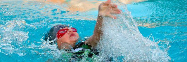 Girl in Backstroke Race