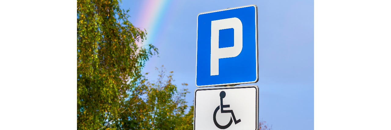 Rainbow over a disability parking space.