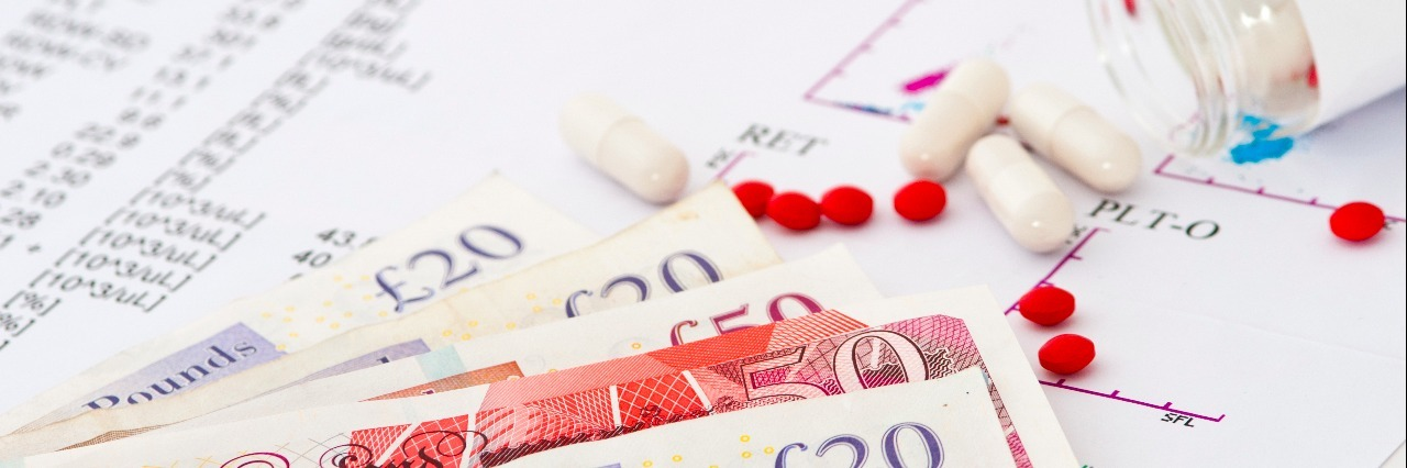 Medical report with test results, pills and money. Concept of expensive healthcare