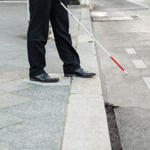 Blind man crossing the street.