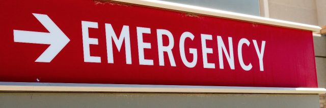 emergency room and main entrance hospital sign