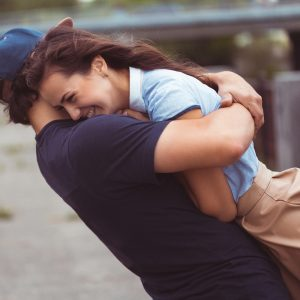 young couple hugging and laughing