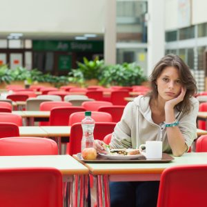 Woman eating lunch alone.