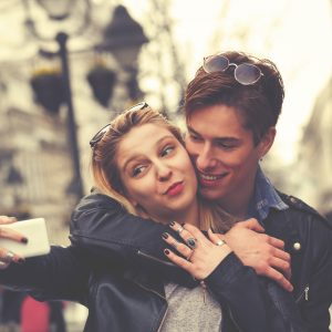 Dating man and woman taking selfie.