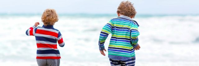 Two kid boys playing on beach