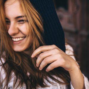 Teen girl laughing.