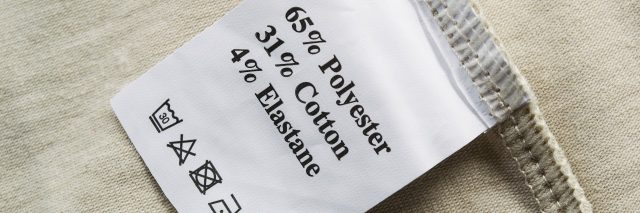beige cloth with fabric label showing washing instructions