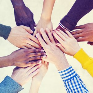 Group of people with hands stacked on top of each other