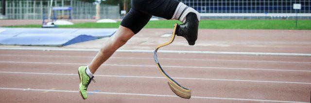 Athlete with prosthetic leg running.