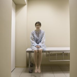 Full length portrait of a woman waiting for medical examination