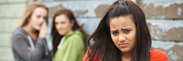 Girl being bullied by peers.