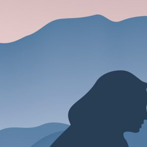 Silhouette of woman's face in front of mountains