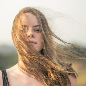 Woman with wind blowing through her hair