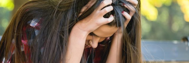 upset nervous stressed woman sitting on bench