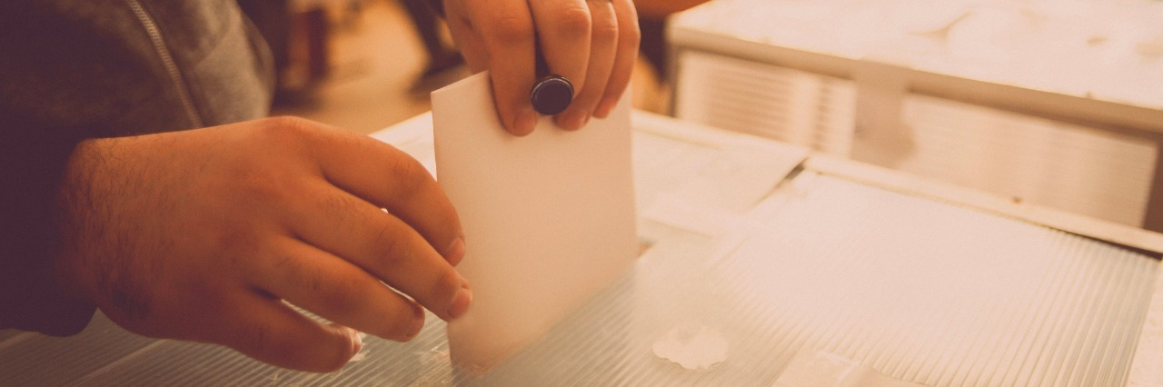 A person casts her ballot during voting for parliamentary elections at a polling station