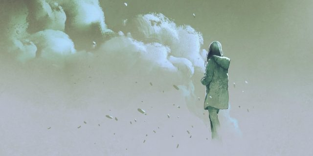 woman standing in front of smoke