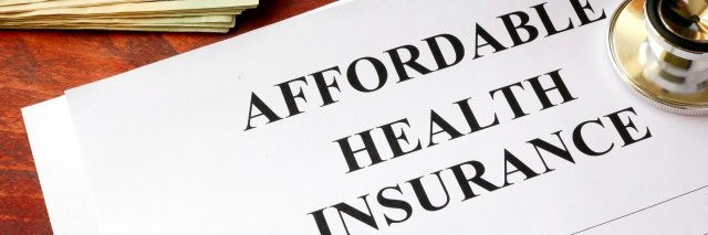 Affordable health insurance policy on a table.