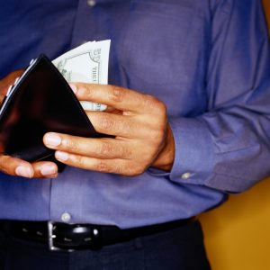 Man Taking Money out of Wallet