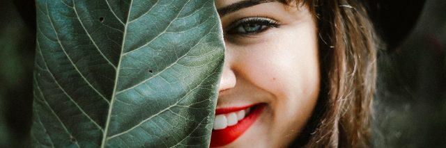 girl hiding leaf