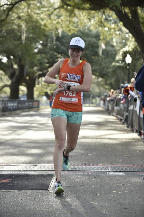 woman running a half marathon