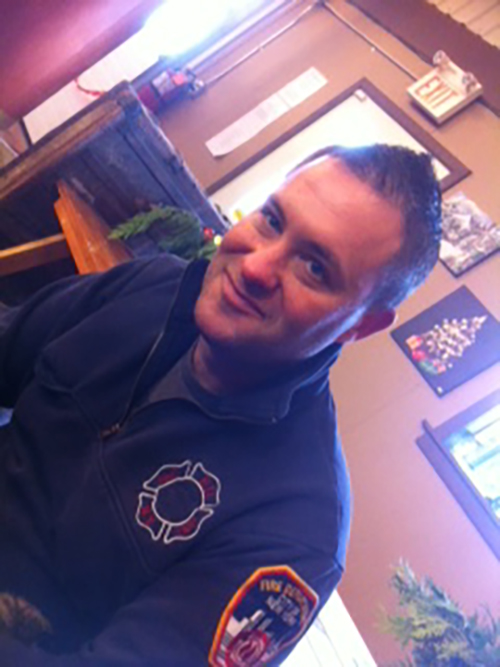 Image of contributor Carl in firefighter uniform