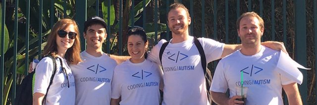 group photo of people wearing coding autism shirts