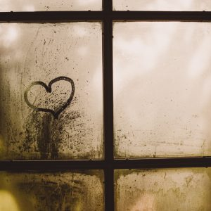 heart on a foggy window