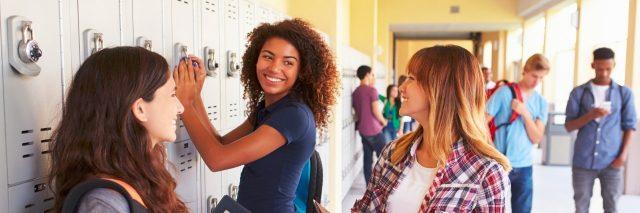 Three high school girls talking by their lockers