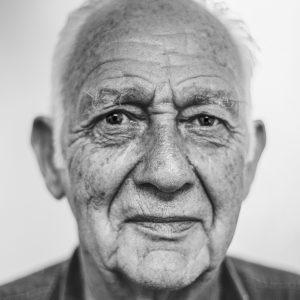 older man looking at camera