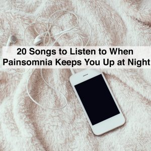 White smartphone with a headphones on crumpled soft beige blanket and text 20 songs to listen to when painsomnia keeps you up at night