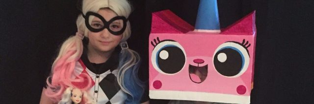 two children dressed as harley quinn and unikitty