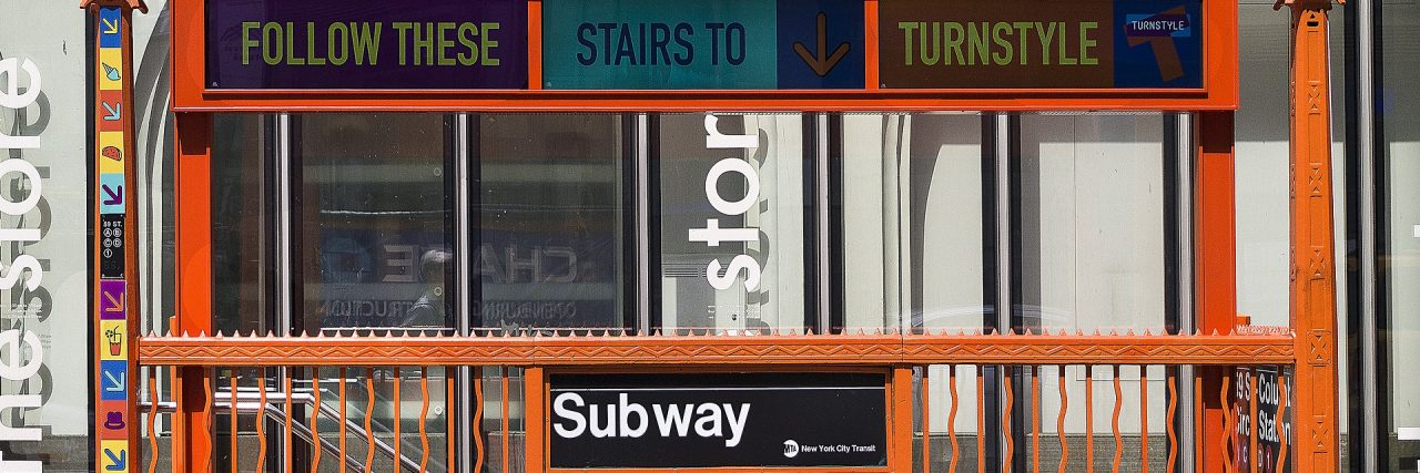 New York City subway entrance with no elevator is inaccessible to people with disabilities.