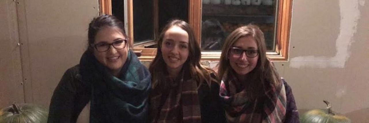 Three female friends sitting together
