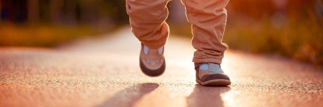 Little legs walking down a path