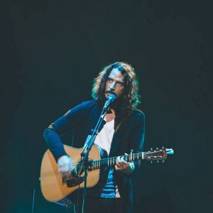Chris Cornell playing guitar on stage