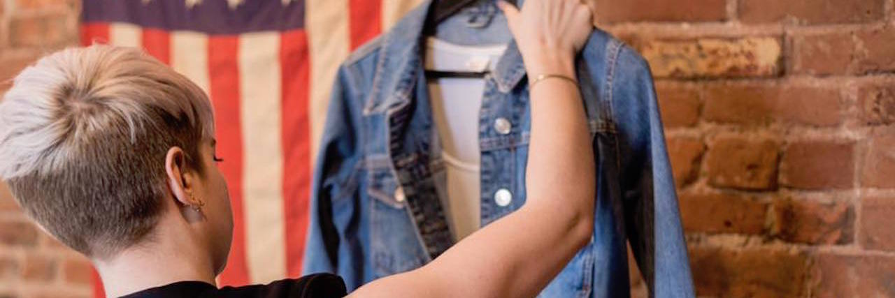 girl looking at jean jacket