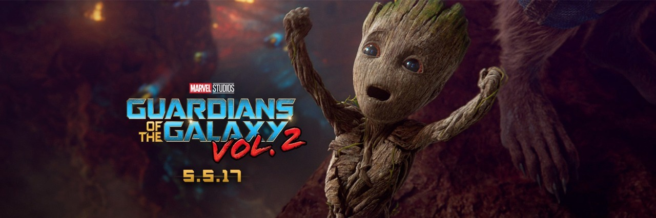 promotional art for guardians of the galaxy vol. 2 with baby groot raising his arms