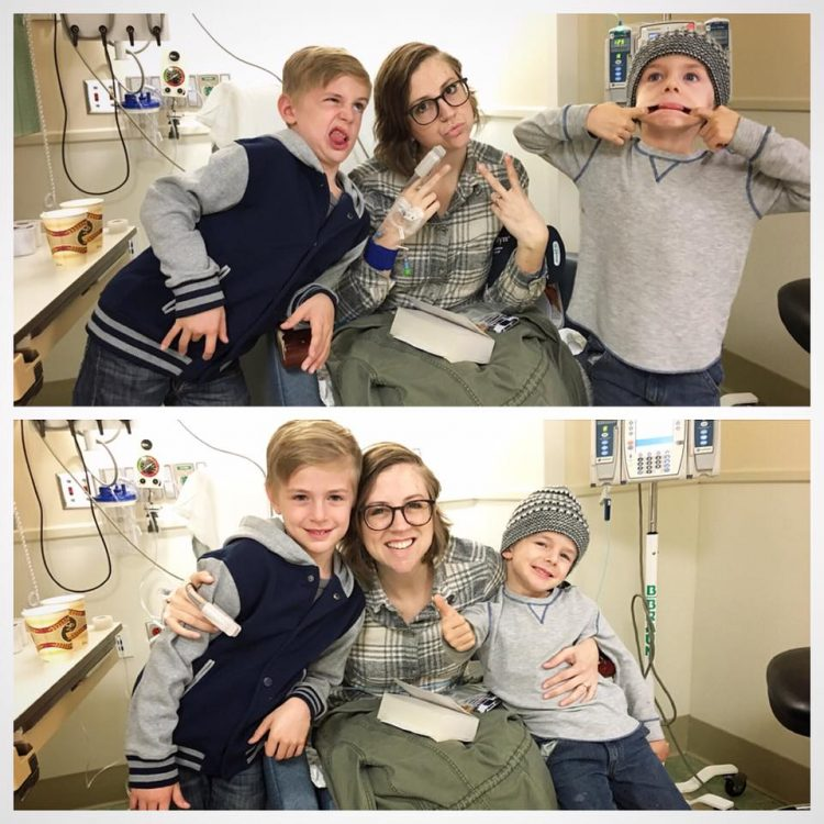 woman in hospital bed with two young boys making silly faces