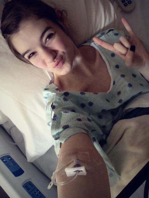 woman in hospital bed smiling