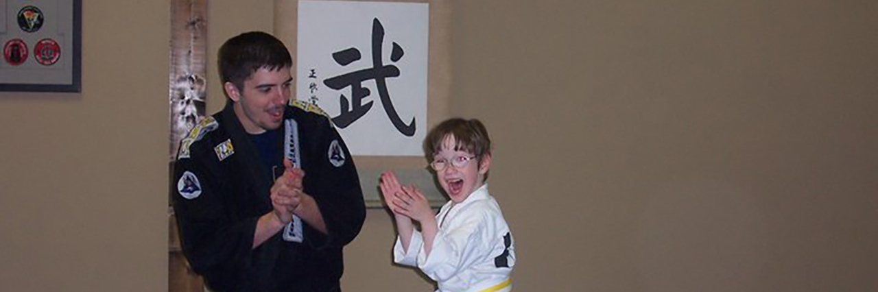 Arlo with his karate teacher.