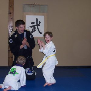 Arlo with his karate teacher.