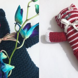 Black knitted bear and red and white knitted bear