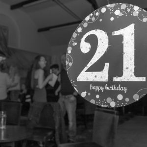 sign on window for 21st birthday party