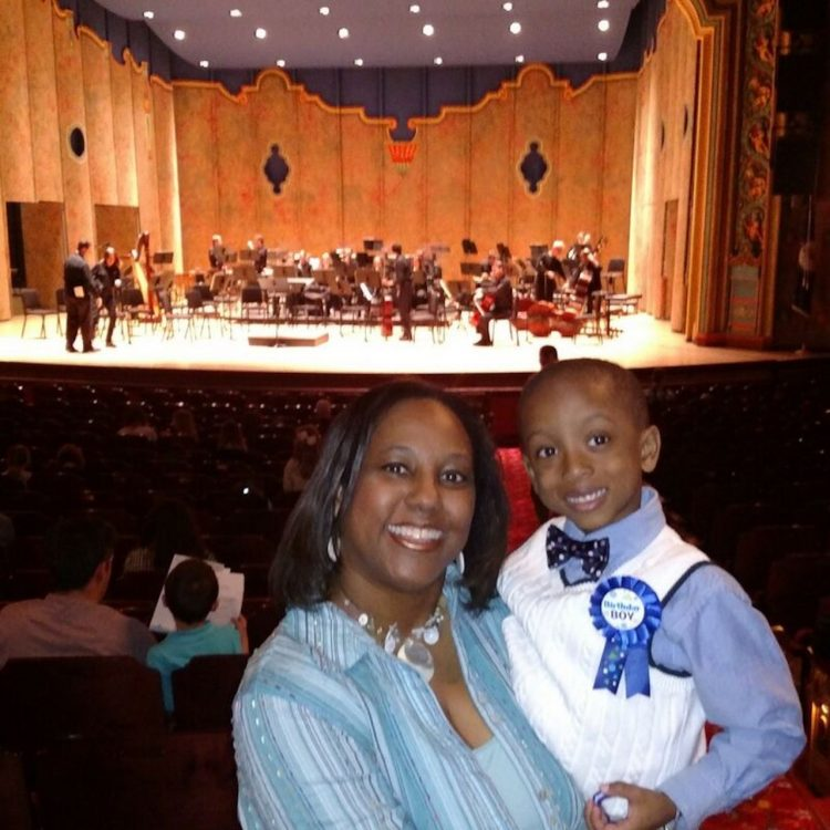 mother and son in the audience at a performance