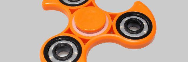 Photo of an orange fidget spinner