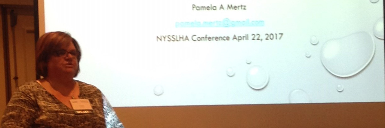Pamela speaking at a conference.
