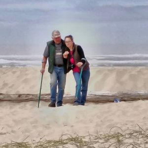Kelcie walking on the beach with a relative.