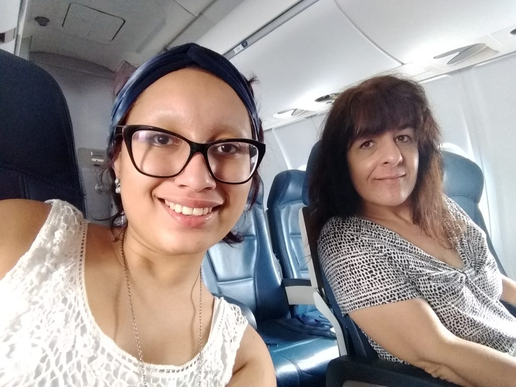 young woman and mother on plane en route to conference