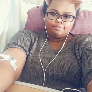 selfie of a woman with an iv in her arm